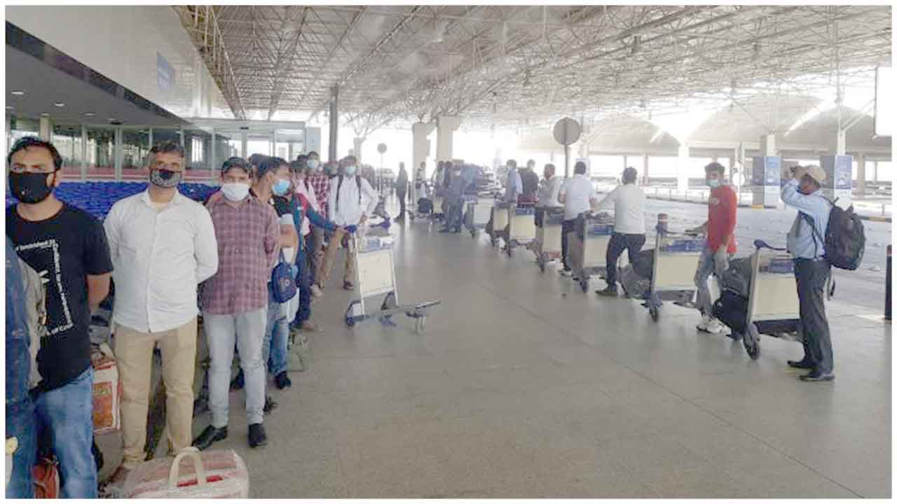 Check-in formalities being done for passengers travelling from Kuwait to Bhubaneswar via Delhi under VandeBharatMission