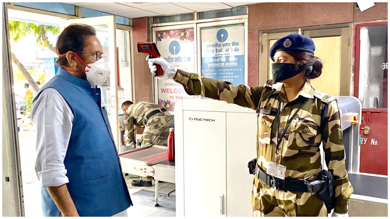 The Union Minister for Minority Affairs, Shri Mukhtar Abbas Naqvi during security person conducting Thermal Screening at entry gate of Minority Affairs Ministry's office in Antyodaya Bhawan, CGO Com
