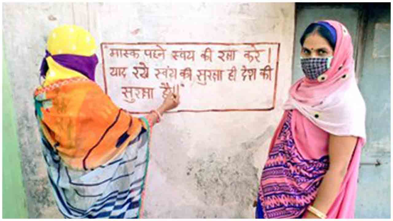Women write slogans and messages to spread Awareness on COVID19 on walls of Anganwadi Centres in MP