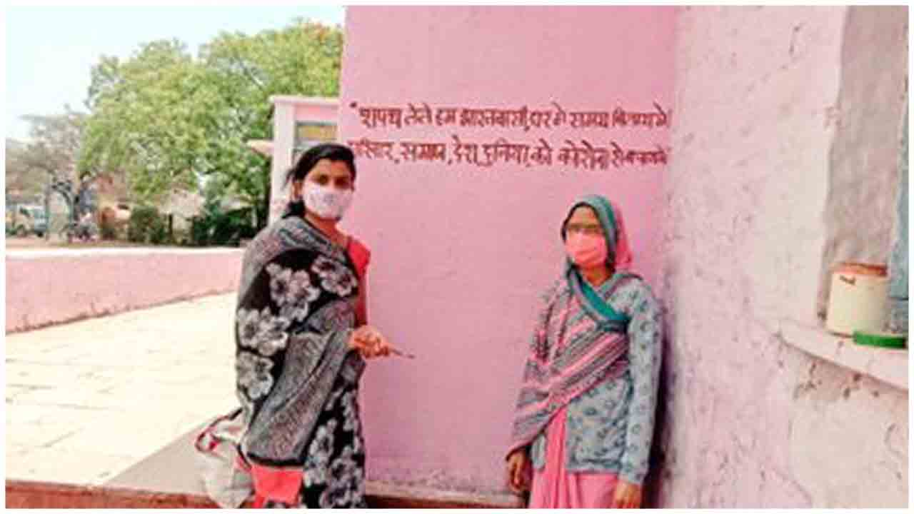 Photo Feature Women Write Slogans And Messages To Spread Awareness On Covid19 On Walls Of Anganwadi Centres In Mp